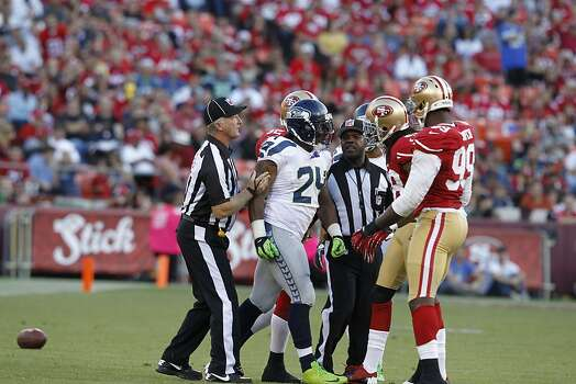 Seattle Seahawks running back Marshawn Lynch (24) and Safety Dashon Goldson (38) have a confrontation on the field during the first quarter of the San Francisco 49ers game against the Seattle Seahawks at Candlestick Park in San Francisco, Calif., on Thursday October 18, 2012. Photo: Brant Ward, The Chronicle