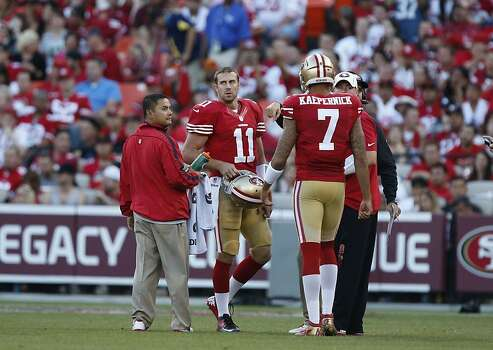 Quarterback Alex Smith (11) takes a moment to switch out a dysfunctional helmet during the first half of the San Francisco 49ers game against the Seattle Seahawks at Candlestick Park in San Francisco, Calif., on Thursday October 18, 2012. Photo: Beck Diefenbach, Special To The Chronicle
