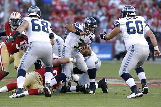 Seattle Seahawks quarterback Russell Wilson (3) is sacked during the second half of the San Francisco 49ers game against the Seattle Seahawks at Candlestick Park in San Francisco, Calif., on Thursday October 18, 2012. Photo: Brant Ward, The Chronicle
