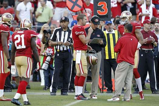 Quarterback Alex Smith (11) talks with coach Jim Harbaugh during the San Francisco 49ers game against the Seattle Seahawks at Candlestick Park in San Francisco, Calif., on Thursday October 18, 2012. Photo: Brant Ward, The Chronicle