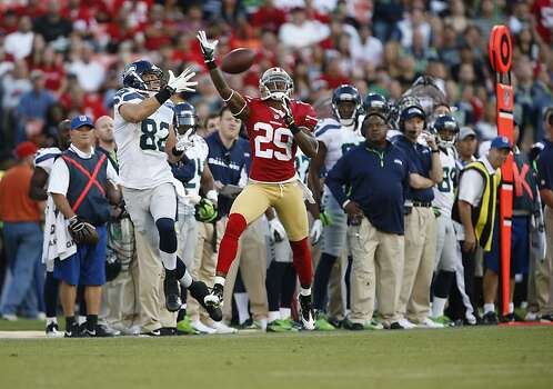 Cornerback Chris Culliver (29) and Seattle Seahawks tight end Evan Moore (82) both reach for a pass in the first half of the San Francisco 49ers game against the Seattle Seahawks at Candlestick Park in San Francisco, Calif., on Thursday October 18, 2012. Photo: Beck Diefenbach, Special To The Chronicle