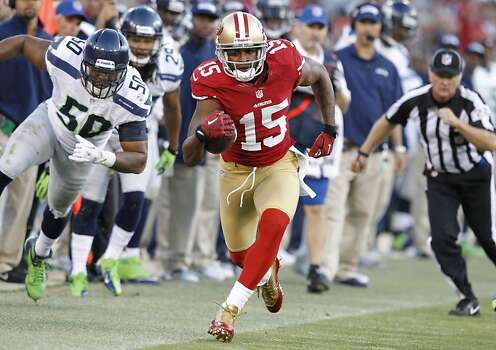 Wide receiver Michael Crabtree (15) has a 16 yard gain for a first down in the San Francisco 49ers game against the Seattle Seahawks at Candlestick Park in San Francisco, Calif., on Thursday October 18, 2012. Photo: Brant Ward, The Chronicle