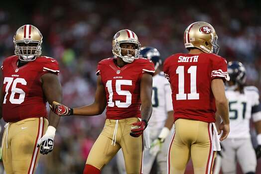 Wide receiver Michael Crabtree (15), Offensive tackle Anthony Davis (76) and Quarterback Alex Smith (11) react to a call during the first half of the San Francisco 49ers game against the Seattle Seahawks at Candlestick Park in San Francisco, Calif., on Thursday October 18, 2012. Photo: Beck Diefenbach, Special To The Chronicle
