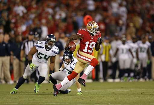 Wide receiver Ted Ginn Jr. (19) runs past the Seattle defense in the first half of the San Francisco 49ers game against the Seattle Seahawks at Candlestick Park in San Francisco, Calif., on Thursday October 18, 2012. Photo: Beck Diefenbach, Special To The Chronicle
