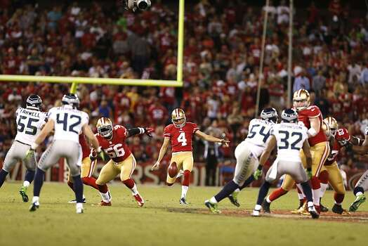 Punter Andy Lee (4) kicks during the first half of the San Francisco 49ers game against the Seattle Seahawks at Candlestick Park in San Francisco, Calif., on Thursday October 18, 2012. Photo: Beck Diefenbach, Special To The Chronicle