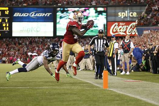 Tight end Delanie Walker (46) scores a touchdown in the third quarter of the San Francisco 49ers game against the Seattle Seahawks at Candlestick Park in San Francisco, Calif., on Thursday October 18, 2012. Photo: Beck Diefenbach, Special To The Chronicle