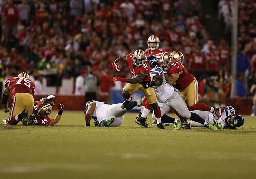 Running back Frank Gore (21) runs through a tackle in the third quarter of the San Francisco 49ers game against the Seattle Seahawks at Candlestick Park in San Francisco, Calif., on Thursday October 18, 2012. Photo: Beck Diefenbach, Special To The Chronicle