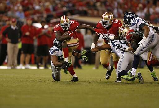 Running back Frank Gore (21) takes off through the Seattle defense during the third quarter of the San Francisco 49ers game against the Seattle Seahawks at Candlestick Park in San Francisco, Calif., on Thursday October 18, 2012. Photo: Beck Diefenbach, Special To The Chronicle