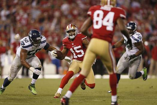 Wide receiver Michael Crabtree (15) runs past Seattle Seahawks linebacker K.J. Wright (50) during the third quarter of the San Francisco 49ers game against the Seattle Seahawks at Candlestick Park in San Francisco, Calif., on Thursday October 18, 2012. Photo: Beck Diefenbach, Special To The Chronicle