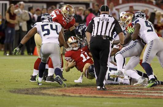 Quarterback Alex Smith (11) sacked in the second quarter of the San Francisco 49ers game against the Seattle Seahawks at Candlestick Park in San Francisco, Calif., on Thursday October 18, 2012. Photo: Brant Ward, The Chronicle