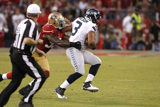 Linebacker NaVorro Bowman (53) takes down Seattle Seahawks quarterback Russell Wilson (3) as he tries to run the ball during the second quarter of the San Francisco 49ers game against the Seattle Seahawks at Candlestick Park in San Francisco, Calif., on Thursday October 18, 2012. Photo: Brant Ward, The Chronicle