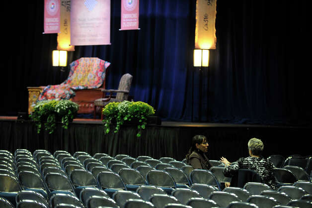 Early arrivees sit near the Dalai Lama's chair on stage at the O'Neill Center on Western Connecticut State University's westside campus in Danbury on Friday, Oct. 19, 2012. Photo: Jason Rearick / The News-Times