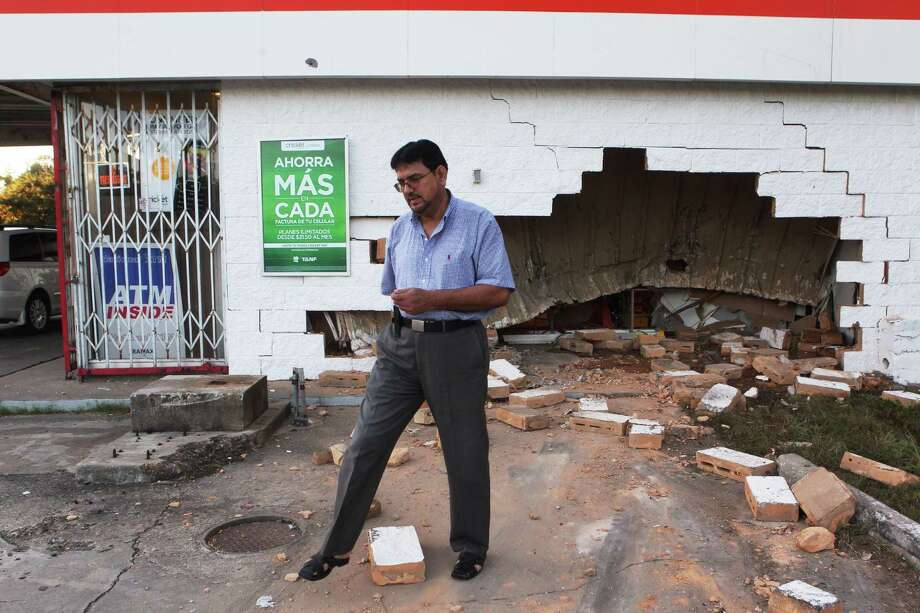 Muhammad Maeem, owner Sunmart 416, at the scene of the early morning attempted crash-burglary, Friday, Oct. 19, 2012. | Johnny Hanson / Houston Chronicle Photo: (Johnny Hanson / Chronicle)