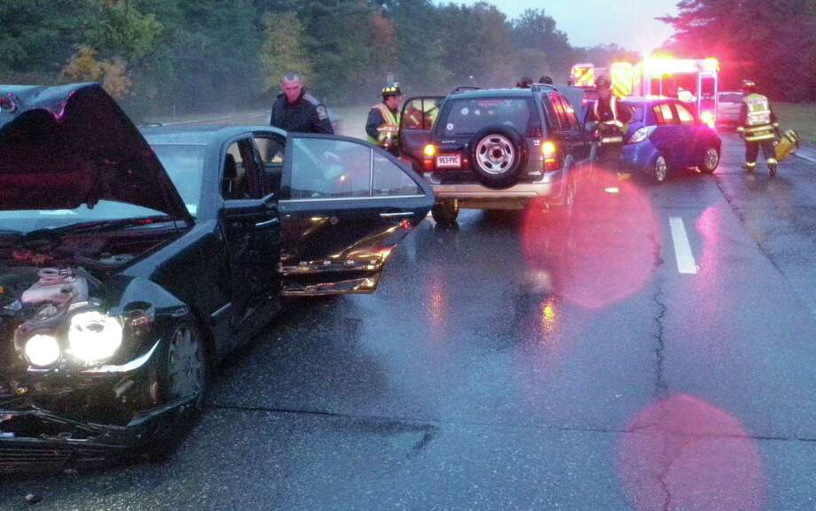 Scene of a four-car accident on the Merritt Parkway in Westport that sent two people to the hospital Friday. Photo: Westport Fire Department / Westport News contributed