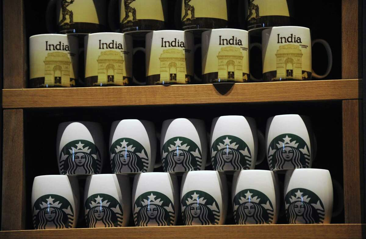 For the coffee hound who has everthing, how about a Starbucks India mug?. They are on sale at the chains first store in India, which opened in Mumbai on Friday, (PUNIT PARANJPE/AFP/Getty Images)
