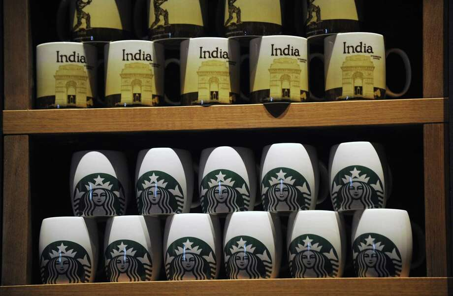 For the coffee hound who has everthing, how about a Starbucks India mug?. They are on sale at the chains first store in India, which opened in Mumbai on Friday,  (PUNIT PARANJPE/AFP/Getty Images) Photo: PUNIT PARANJPE, Ap/getty / 2012 AFP