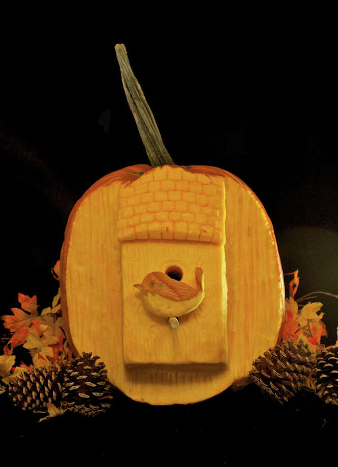 This undated publicity photo provided by Maniac Pumpkin Carvers shows a bird house scene carved on a pumpkin. For at least three months each Fall, pumpkin carvers Marc Evan and Chris Soria, of New York City, relinquish their illustrator occupations to carve fantastical pumpkins full-time to become the Maniac Pumpkin Carvers. (AP Photo/Maniac Pumpkin Carvers) Photo: Marc Evan, Associated Press / Maniac Pumpkin Carvers