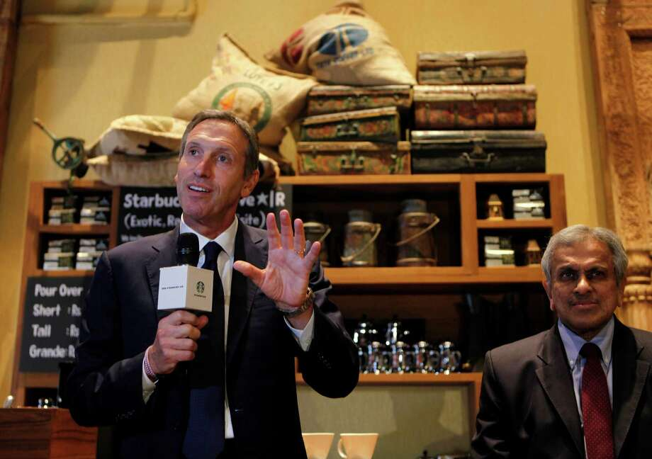 Shultz and Starbucks aren't going it alone. They have a partner in the deal, Tata Global Beverages.  At right is vice chairman of the Tata Global Beverages, R.K. Krishna Kumar. (AP Photo/Rajanish Kakade) Photo: Ap/getty