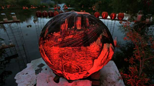 "Illuminated jack o' lanterns, with many themes including the movie ""Titanic"" are displayed at the Roger Williams Park Zoo in Providence, R.I., Monday, Oct. 8, 2012. Some 5,000 carved pumpkins are on display for this year's Jack-o'-lantern Spectacular, one of the nation's largest jack-o'-lantern shows. (AP Photo/Charles Krupa) Photo: Charles Krupa, Associated Press / AP"
