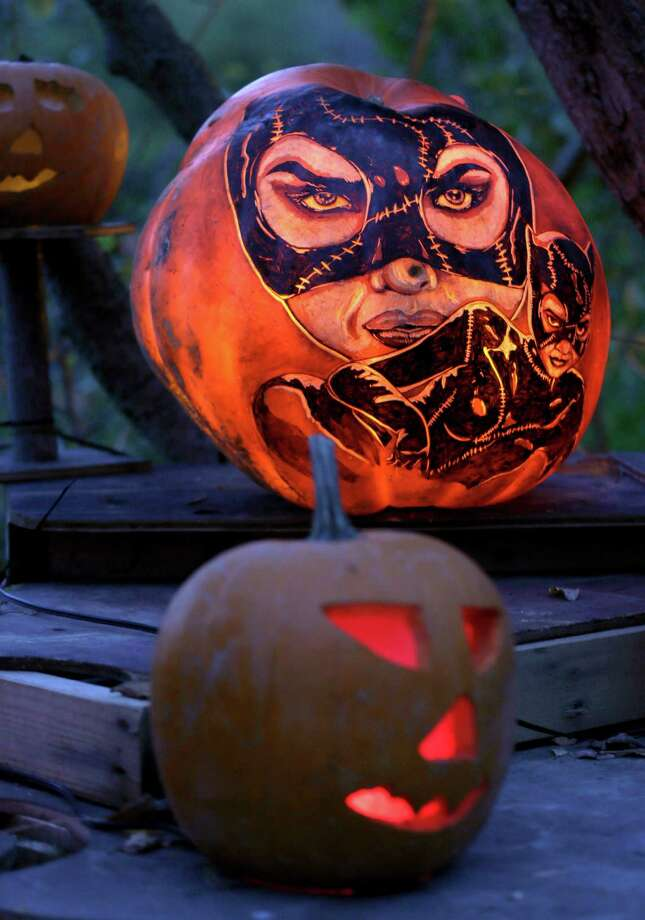 "Illuminated jack o' lanterns, with many themes including the movie ""Cat Woman"" are displayed at the Roger Williams Park Zoo in Providence, R.I., Monday, Oct. 8, 2012. Some 5,000 carved pumpkins are on display for this year's Jack-o'-lantern Spectacular, one of the nation's largest jack-o'-lantern shows. (AP Photo/Charles Krupa) Photo: Charles Krupa, Associated Press / AP"