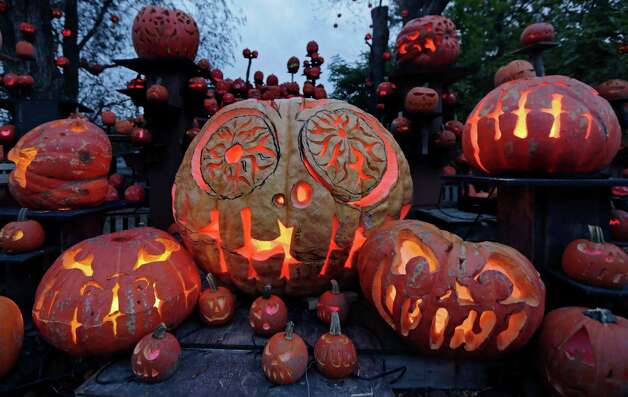 Illuminated jack o' lanterns are seen at the Roger Williams Park Zoo in Providence, R.I., Monday, Oct. 8, 2012. Some 5,000 carved pumpkins are on display for this year's Jack-o'-lantern Spectacular, one of the nation's largest jack-o'-lantern shows. (AP Photo/Charles Krupa) Photo: Charles Krupa, Associated Press / AP