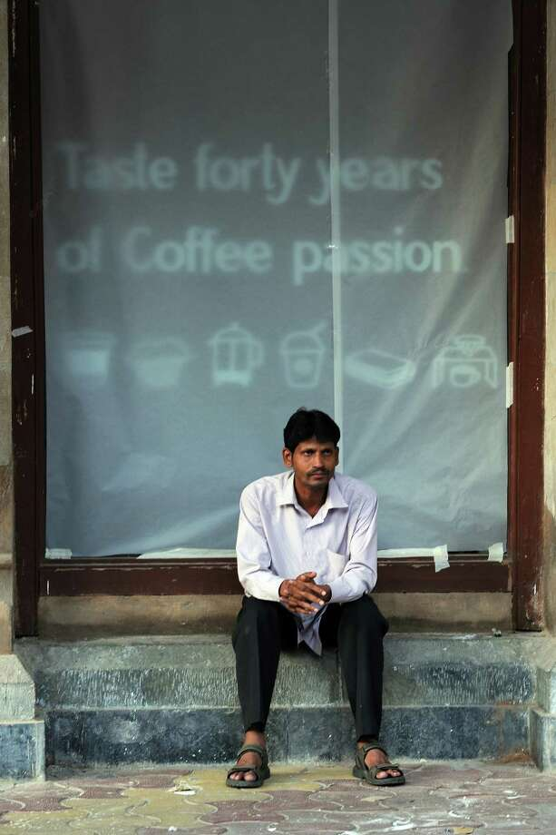 Earlier this week, you could only sit and wait for the Mumbai Starbucks to open. (INDRANIL MUKHERJEE/AFP/Getty Images) Photo: INDRANIL MUKHERJEE, Ap/getty / 2012 AFP