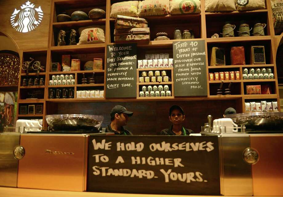 The coffee is bold, and so is the staff at the first Starbucks in India.   (PUNIT PARANJPE/AFP/Getty Images) Photo: Ap/getty