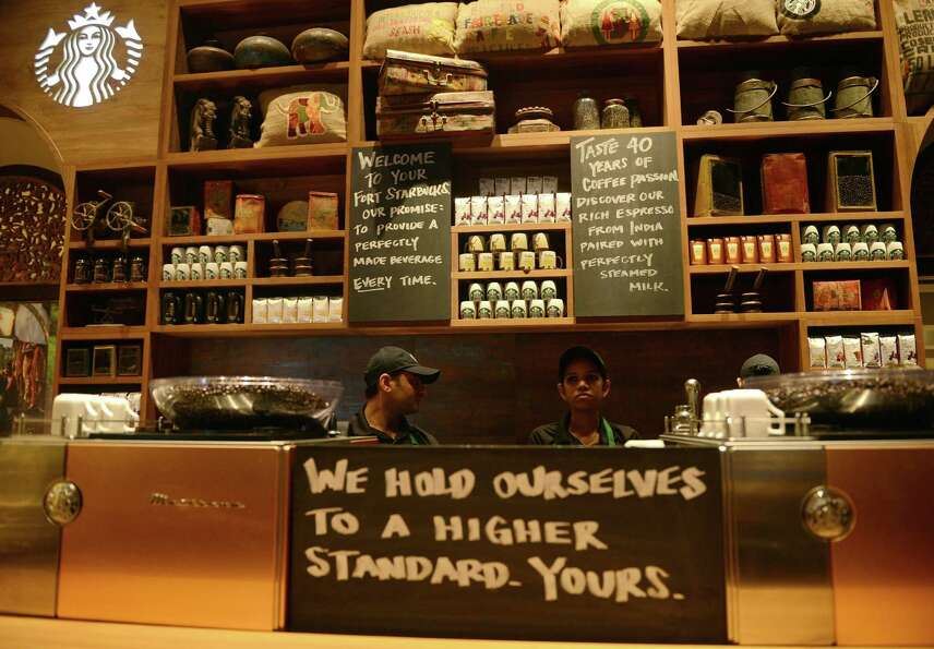 The coffee is bold, and so is the staff at the first Starbucks in India.   (PUNIT PARANJPE/AFP/Getty