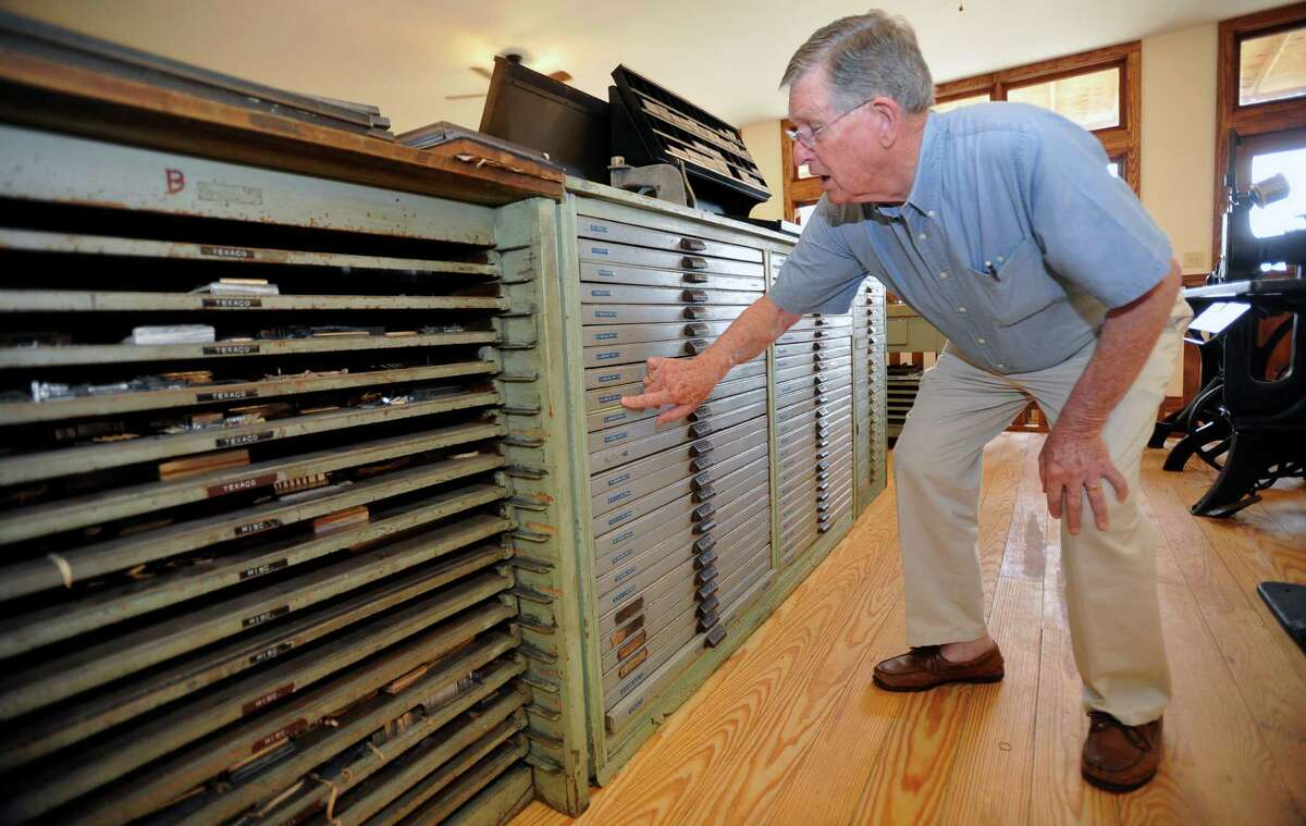 Tom Lamb, right, talks about all that it took to pull all this stuff out of storage and move it to it's new location at the Spindletop-Gladys City Boomtown Museum. These drawers contain lead type in all different fonts and point sizes. In the late 1800s, the Lamb family opened a printing shop on the sidewalk in the heart of downtown Beaumont. They helped start and print the Beaumont Enterprise, and officially opened Lamb's Printing Company in 1895. Tom Lamb, the last president of the family business, preserved a full set of printing and type setting machines which will be on display beginning Oct. 27 at the Gladys City Boomtown Museum. Dave Ryan/The Enterprise