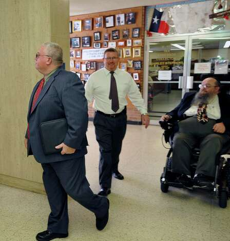 Kountze ISD School Superintendent Kevin Weldon, left, heads back to the second floor after lunch. Attorneys were  back in the 356 District Court Thursday morning October 18, 2012 before Judge Steve Thomas. After hearing more arguments before lunch, Thomas announced after lunch that he would grant the temporary injunction till the jury trial date of June 24, 2013.   The Kountze cheerleaders extended temporary restraining order was due to expire Thursday at midnight. Dave Ryan/The Enterprise