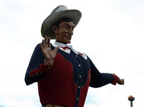 Big Tex announces fair events throughout the day, while giving hearty  howdys  to passers-by. This year marks the 60th anniversary of Big Tex. Photo: San Antonio Express-News