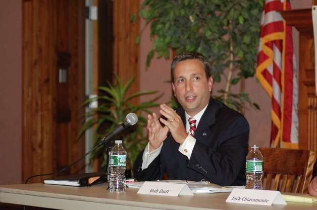 State Sen. Bob Duff (D-Norwalk, Darien) debates with Republican challenger Jack Chiaramonte, chairman of Norwalk's Board of Education, during a forum at Norwalk City Hall Monday night. Photo: Nicole Rivvard