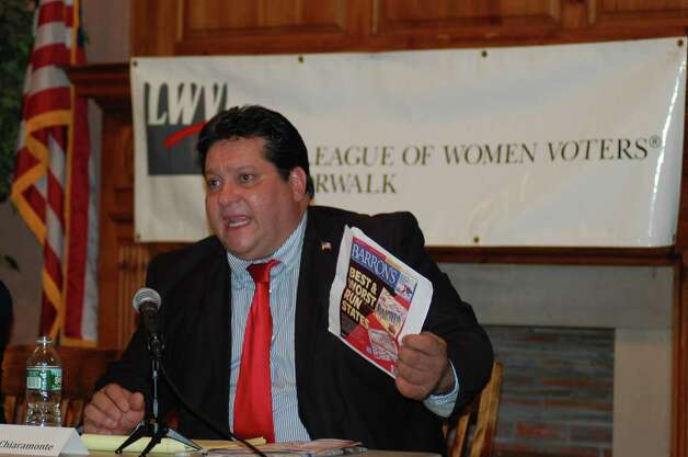 During a 25th district state Senate forum Monday night at Norwalk City Hall, Republican challenger Jack Chiaramonte, chairman of Norwalk's Board of Education, holds up copy of Barron's magazine, which ranked Connecticut among the worst-run states in terms of its finances. Photo: Nicole Rivard
