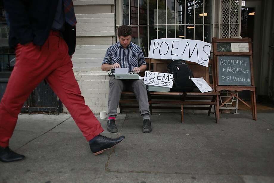 Using with beloved 1967 Hermes typewritter, Zach Houston pecks out a poem on Valencia Street in San Francisco. Photo: Mike Kepka, The Chronicle