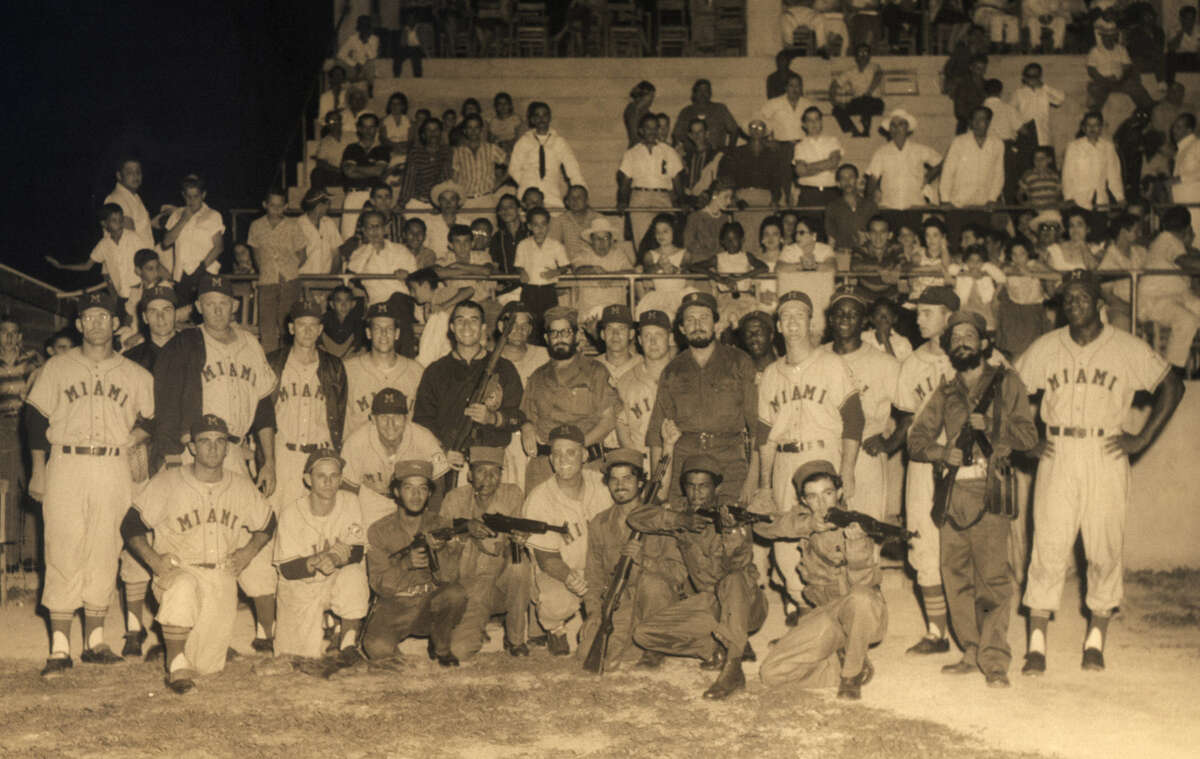 Members of the International League Miami Marlins pose in Havana, Cuba with gun-toting members of Fidel Castro's Barbitos in this April 10, 1959, photo. During the team's stay in Cuba, its manager, Pepper Martin, squatting second row, fourth from left, and Castro became buddies, spending hours huddled in restaurants talking baseball with each other.