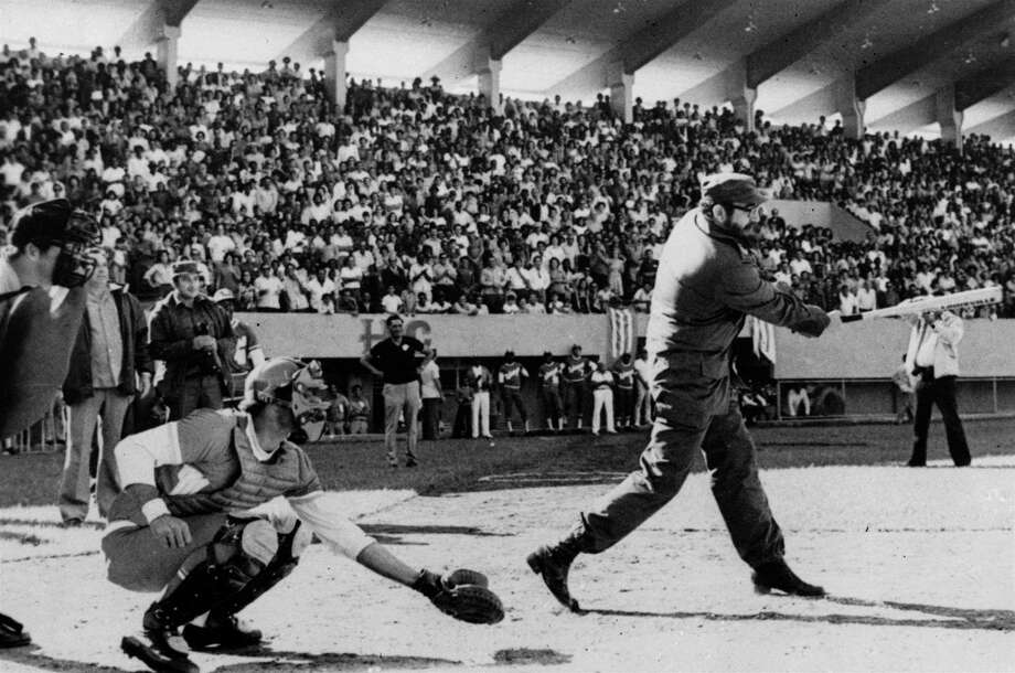 Cuba's premier Fidel Castro takes a swing at the first pitch of an inter-provincial baseball championship in Cuba, February 20, 1977. Photo: PRENSA LATINA, AP / PRENSA LATINA