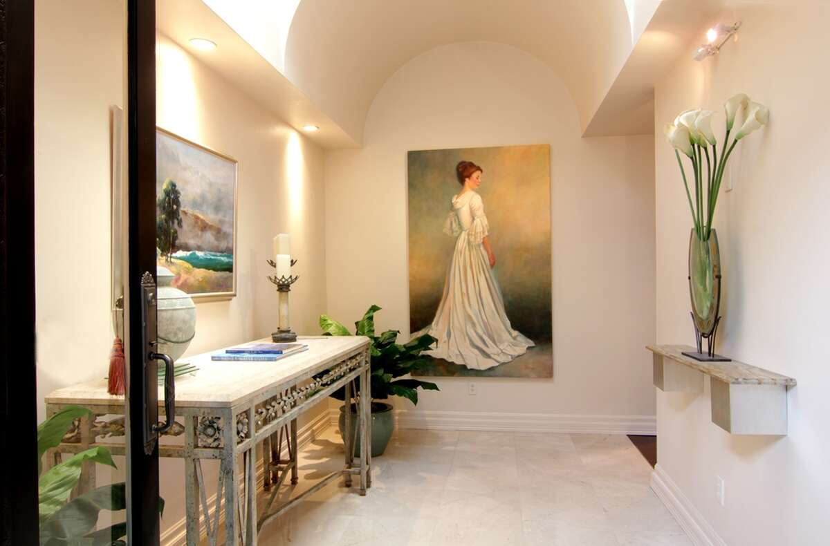 An entrance should be light and bright and let the chi flow benevolently into the home. Katherine Ashby feng shui'ed this house.