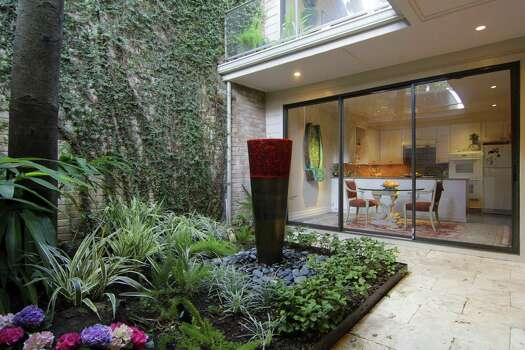 Get your home 39 s chi flowing like a river houston chronicle for Homes with enclosed courtyards