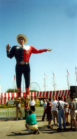 Big Tex is 52 feet tall and sports a belt 23 feet long. Visitors love to be photographed in front of him. October 2002. Photo: Terry Scott Bertling, San Antonio Express-News / SAN ANTONIO EXPRESS-NEWS