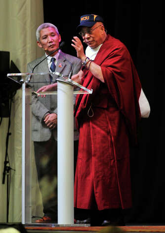 "The Dalai Lama gives his ""Advice for Daily Life"" speech, with the help of interpreter Thupten Jinpa, left, at the O'Neill Center on Western Connecticut State University's westside campus in Danbury on Friday, Oct. 19, 2012. Photo: Jason Rearick / The News-Times"
