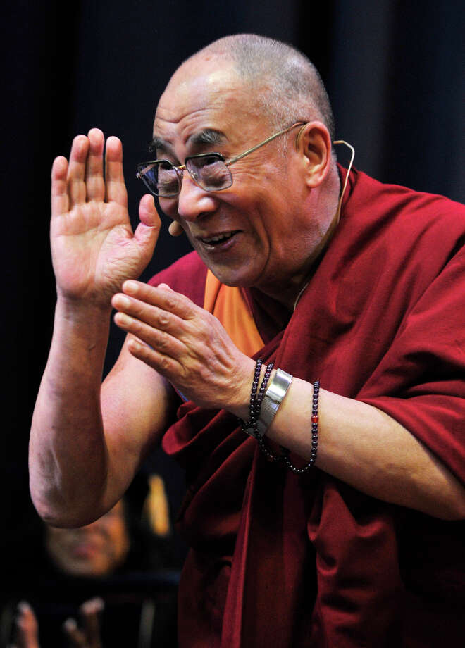 """The Dalai Lama greets the crowd at the O'Neill Center before giving his speech """"Advice for Daily Life"""" on Western Connecticut State University's westside campus in Danbury on Friday, Oct. 19, 2012. Photo: Jason Rearick / The News-Times"""
