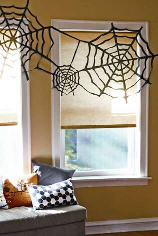 Get creepy with spider webs made from garbage bags, the creative genius of graphic designer Jessica Jones, who blogs at How About Orange. Photo: From How About Orange
