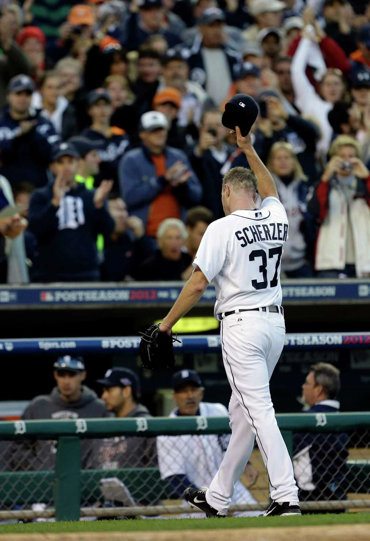 Detroit Tigers' Max Scherzer salutes after being taken out of the game in the sixth inning during Game 4 of the American League championship series against the New York Yankees Thursday, Oct. 18, 2012, in Detroit.