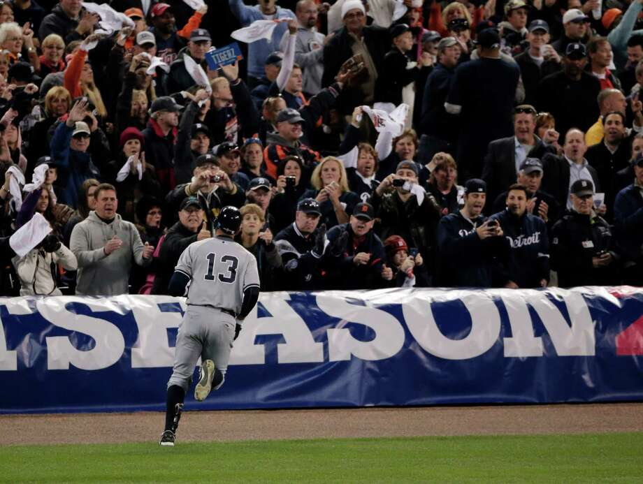 New York Yankees' Alex Rodriguez runs back to the dugout after grounding out in the ninth inning during Game 4 of the American League championship series against the Detroit Tigers, Thursday, Oct. 18, 2012, in Detroit. The Tigers won 8-1 and move on to the World Series. Photo: Charlie Riedel, AP / AP