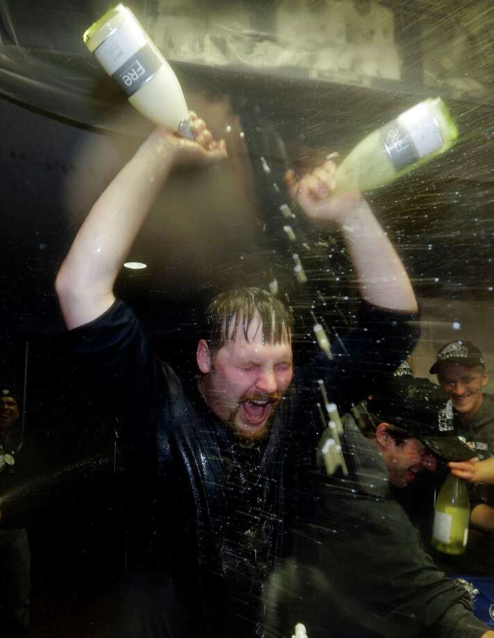 Detroit Tigers' Phil Coke gives himself a celebratory dousing in the locker room after his team won Game 4 of the American League championship series 8-1, against the New York Yankees, Thursday, Oct. 18, 2012, in Detroit. The Tigers move on to the World Series. Photo: Paul Sancya, AP / AP