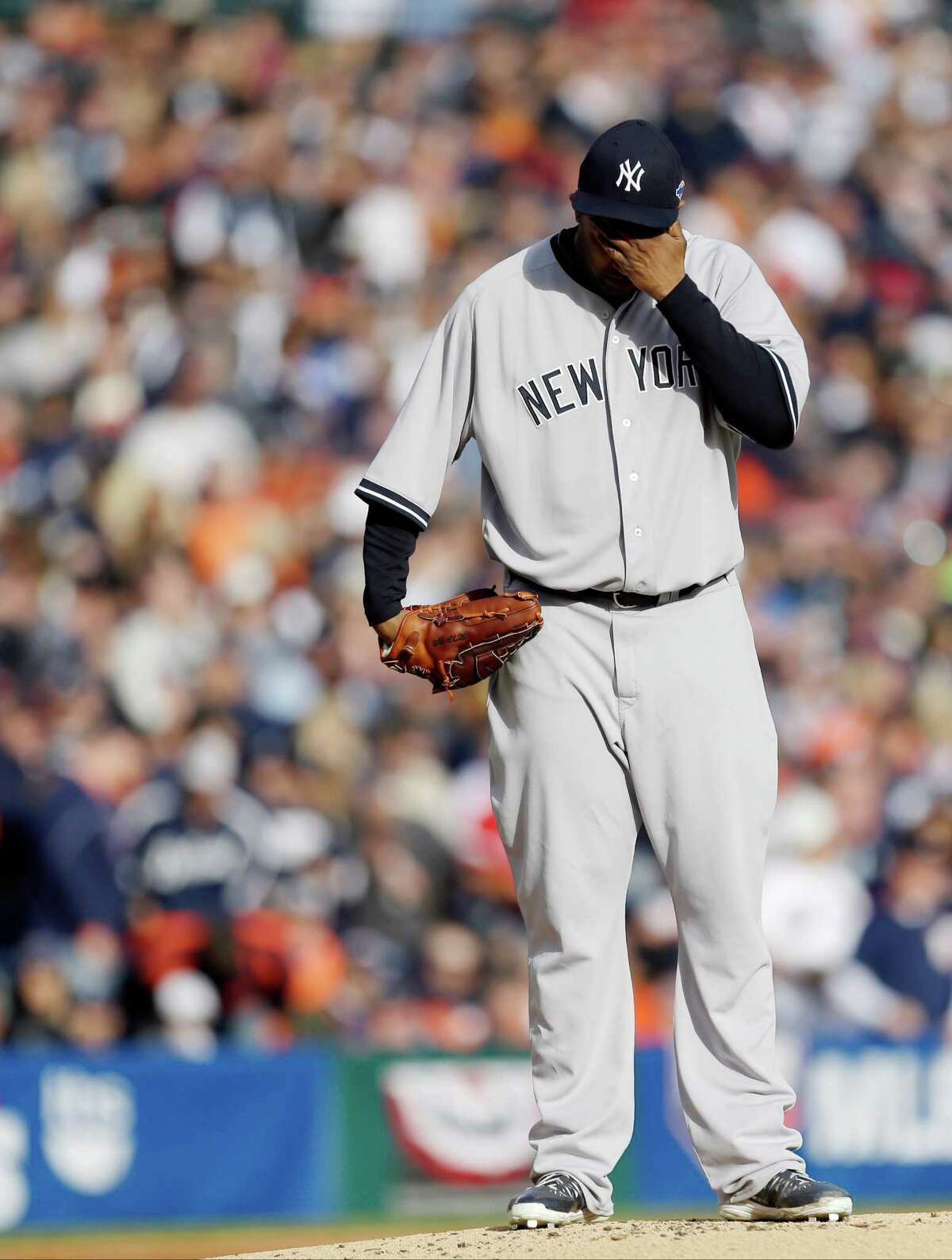 New York Yankees' CC Sabathia wipes his face after Detroit Tigers' Omar Infante scored in the first inning during Game 4 of the American League championship series Thursday, Oct. 18, 2012, in Detroit.