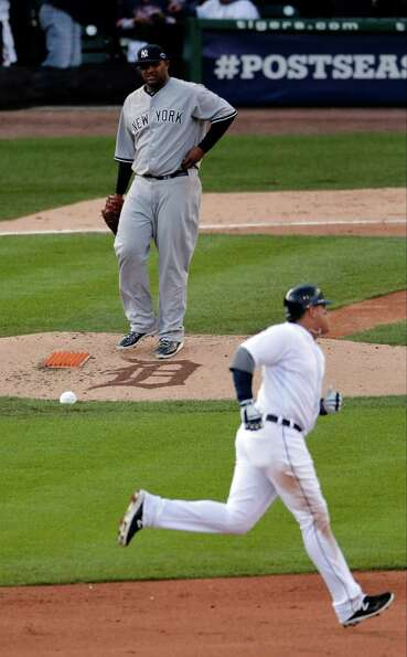 New York Yankees' CC Sabathia watches after Detroit Tigers' Miguel Cabrera hits a two run home run i