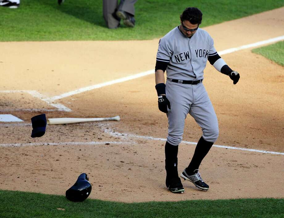 New York Yankees' Nick Swisher leaves home plate after striking out to end the third inning during Game 4 of the American League championship series against the Detroit Tigers Thursday, Oct. 18, 2012, in Detroit. Photo: Carlos Osorio, AP / AP