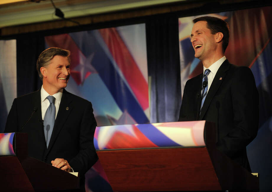 Republican challenger Steve Obsitnik, left, and U.S. Rep. Jim Himes share a laugh after Obsitnik stated that he agreed with Himes on the issue of defense during the U.S. Congressional Fourth District Debate at the Norwalk Inn & Conference Center in Norwalk on Thursday, October 18, 2012. Photo: Brian A. Pounds / Connecticut Post