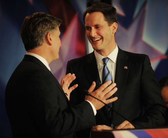 Republican challenger Steve Obsitnik, left, and U.S. Rep. Jim Himes chat prior to the start of the U.S. Congressional Fourth District Debate at the Norwalk Inn & Conference Center in Norwalk on Thursday, October 18, 2012. Photo: Brian A. Pounds / Connecticut Post